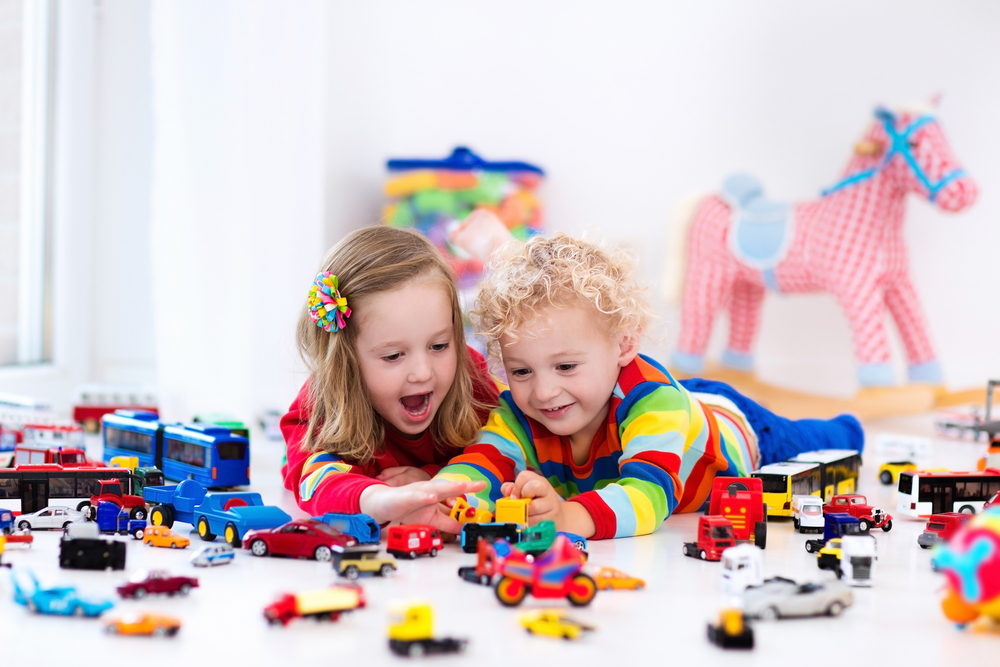 children friends playing with toys